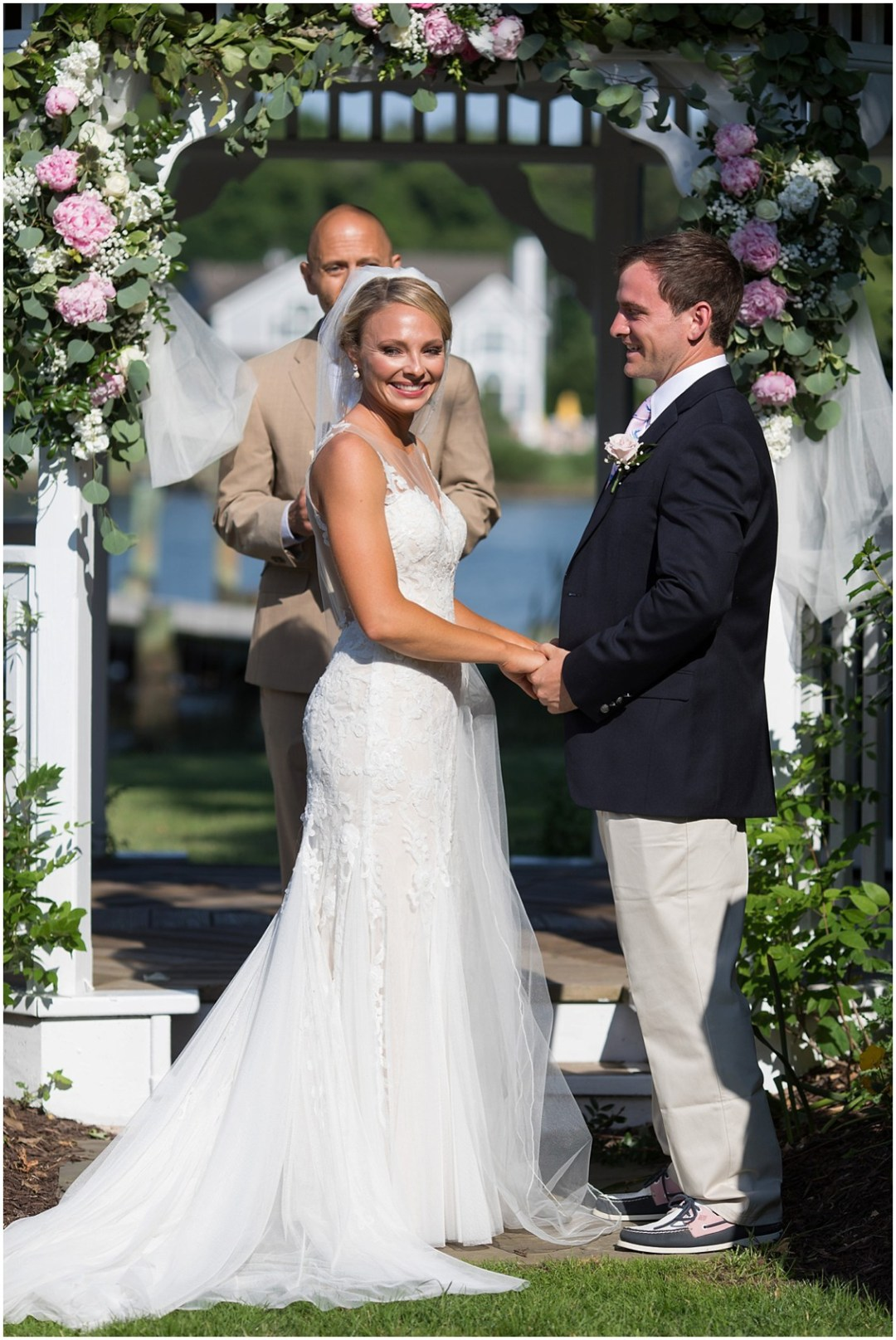 Bride and groom at the wedding altar, clasping hands. | My Eastern Shore Wedding |