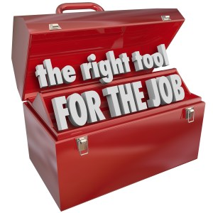 The Right Tool for the Job words in a red metal toolbox to illus