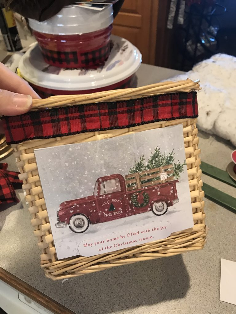 red truck basket with red ribbon wrapped around the top