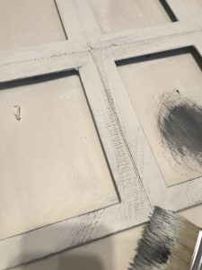 distressing the window with black paint
