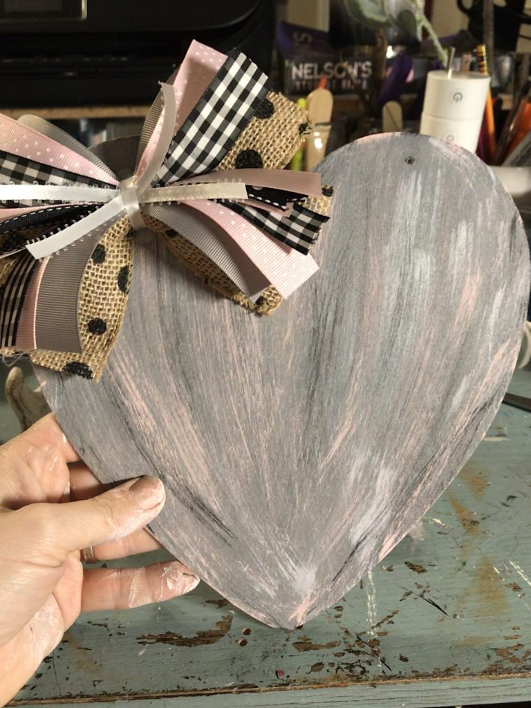 painted dollar tree wooden heart with a re-fabbed bow