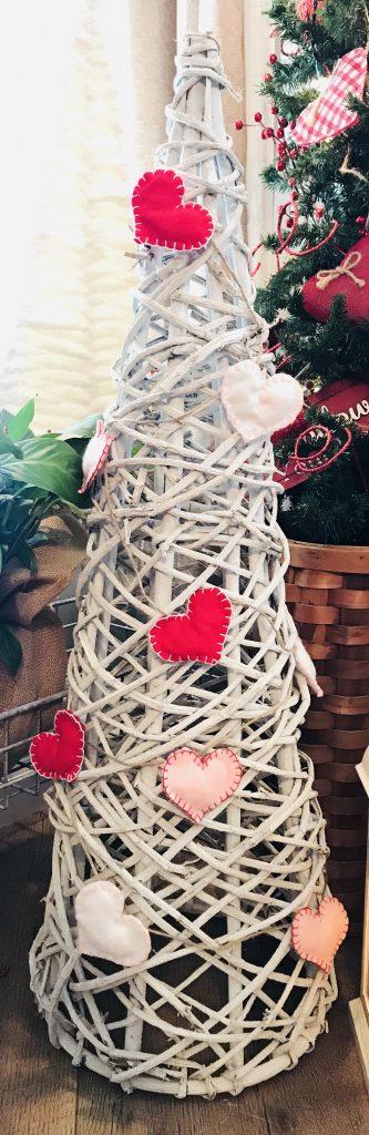 Felt heart garland wrapped around a grapevine tree