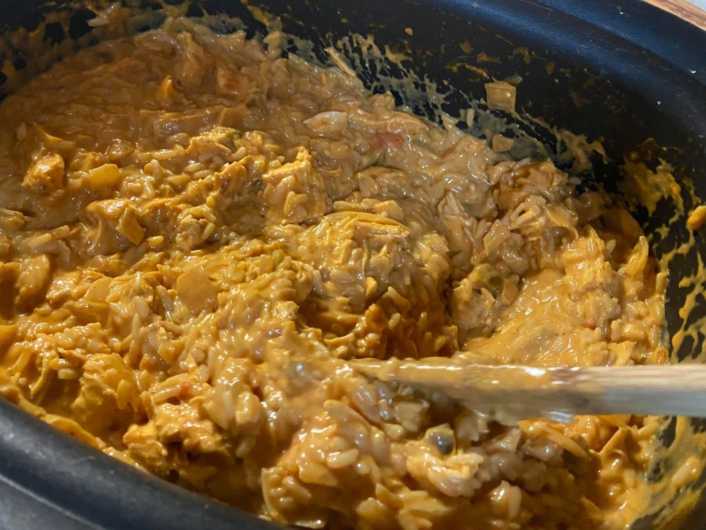 stirring our cheesy chicken and rice taco soup