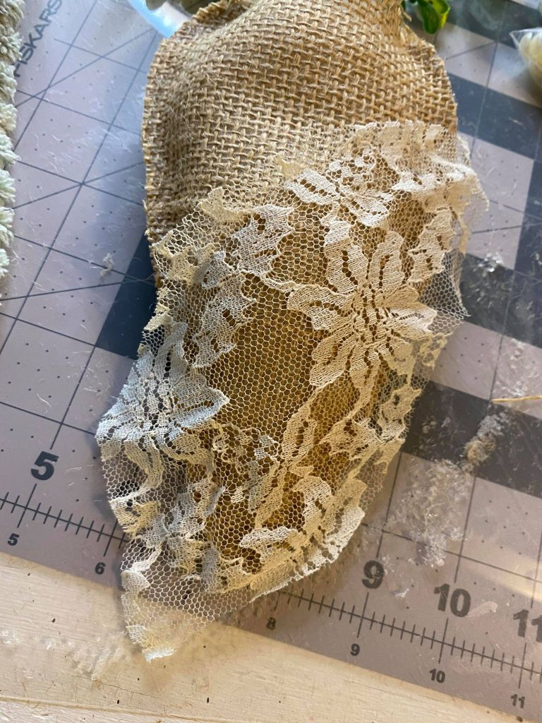 adding lace to the outside of a burlap carrot