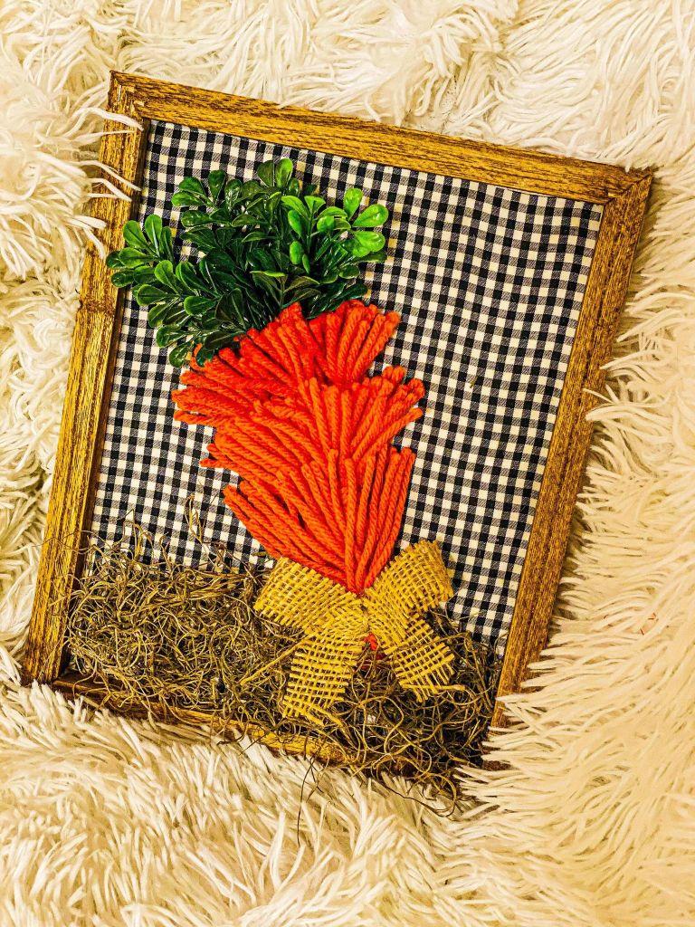 carrot made with orange yarn tassels