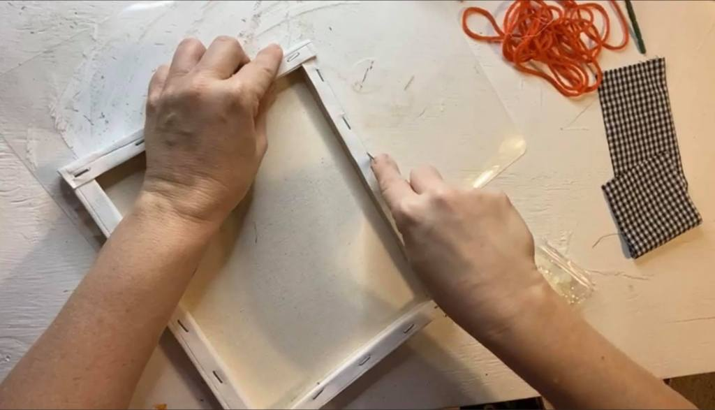removing the canvas from the frame for a reverse canvas craft