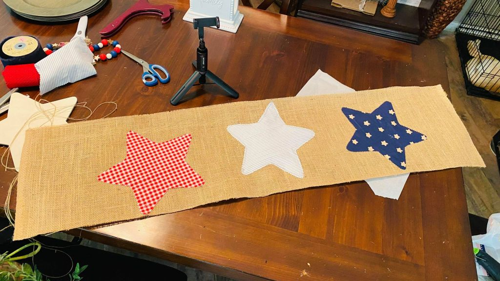 fabric stars added to a burlap table runner
