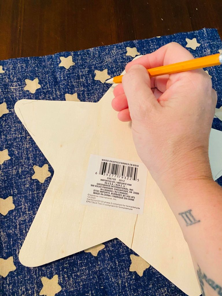 cutting stars out of fabric for a patriotic table runner