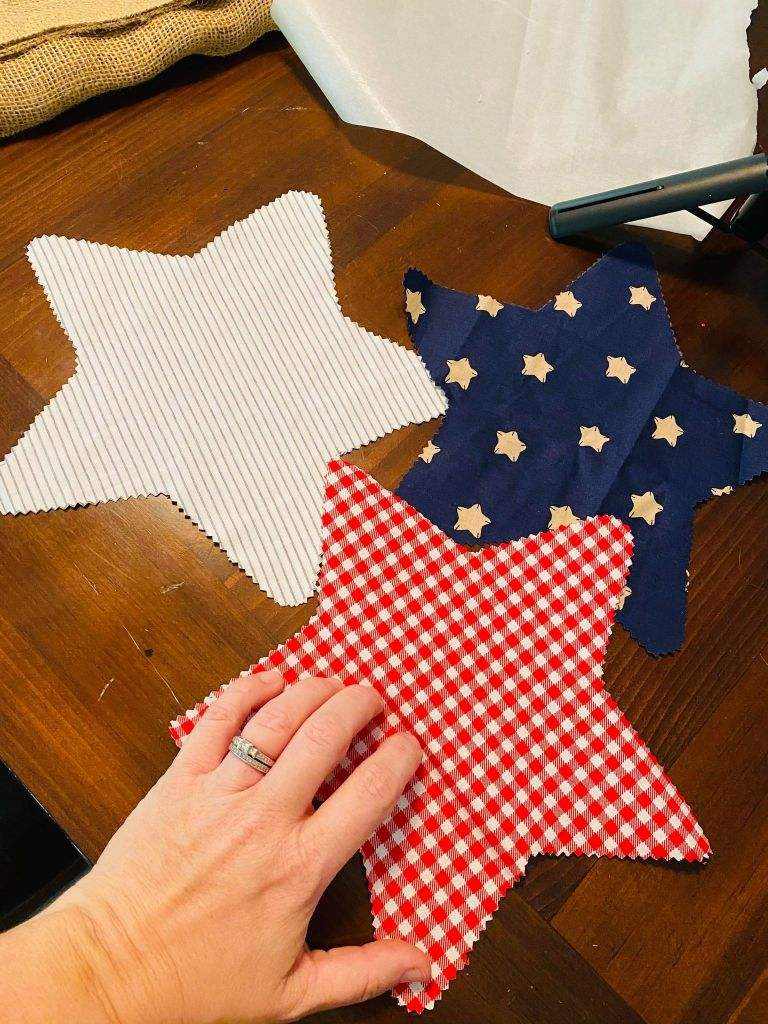 three stars cut out of fabric for a patriotic table runner