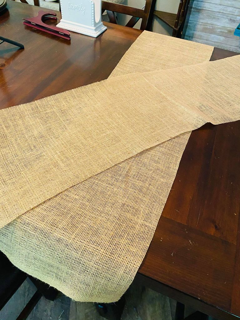 two cut pieces of burlap for a patriotic table runner