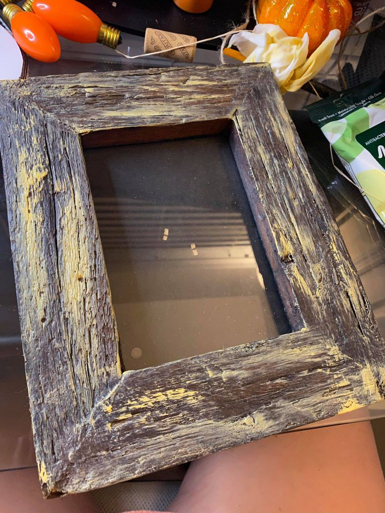 wooden frame being dry brushed with mustard colored yellow paint