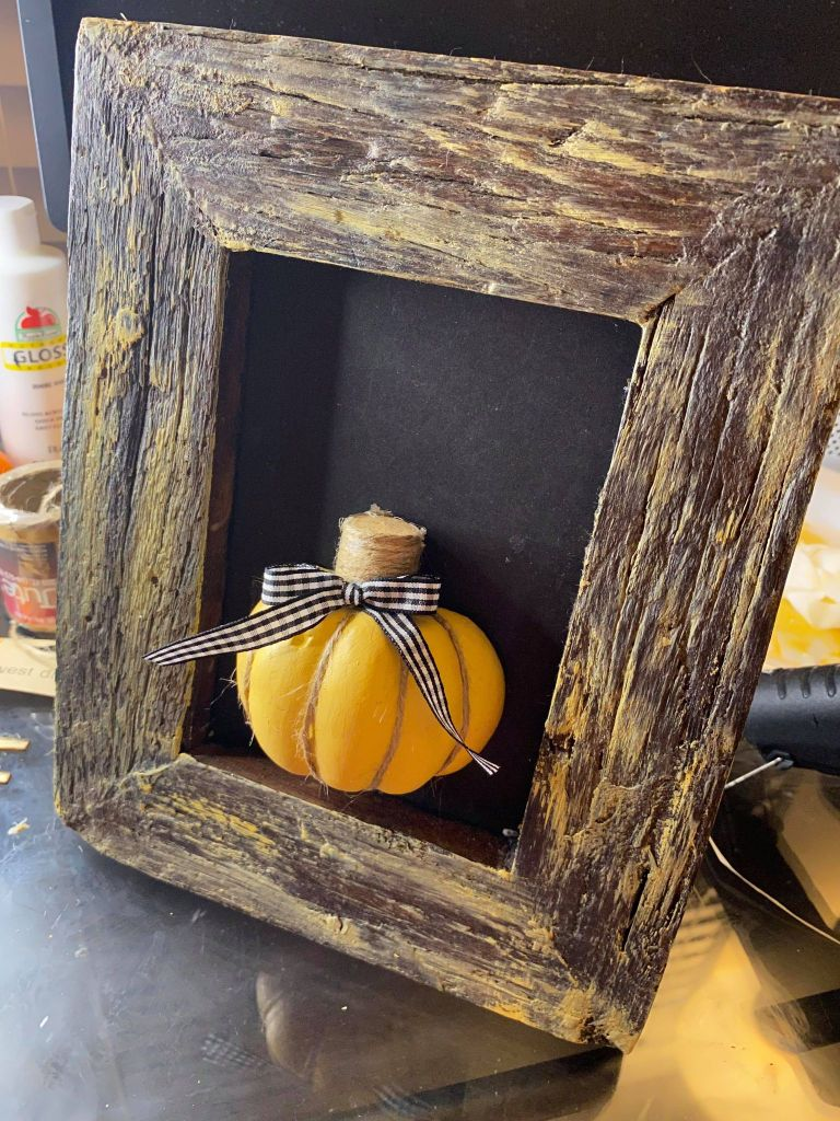 gingham bow added to the stem of a pumpkin