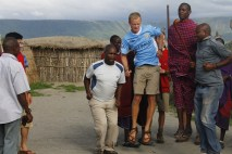 Masai dancing with students.