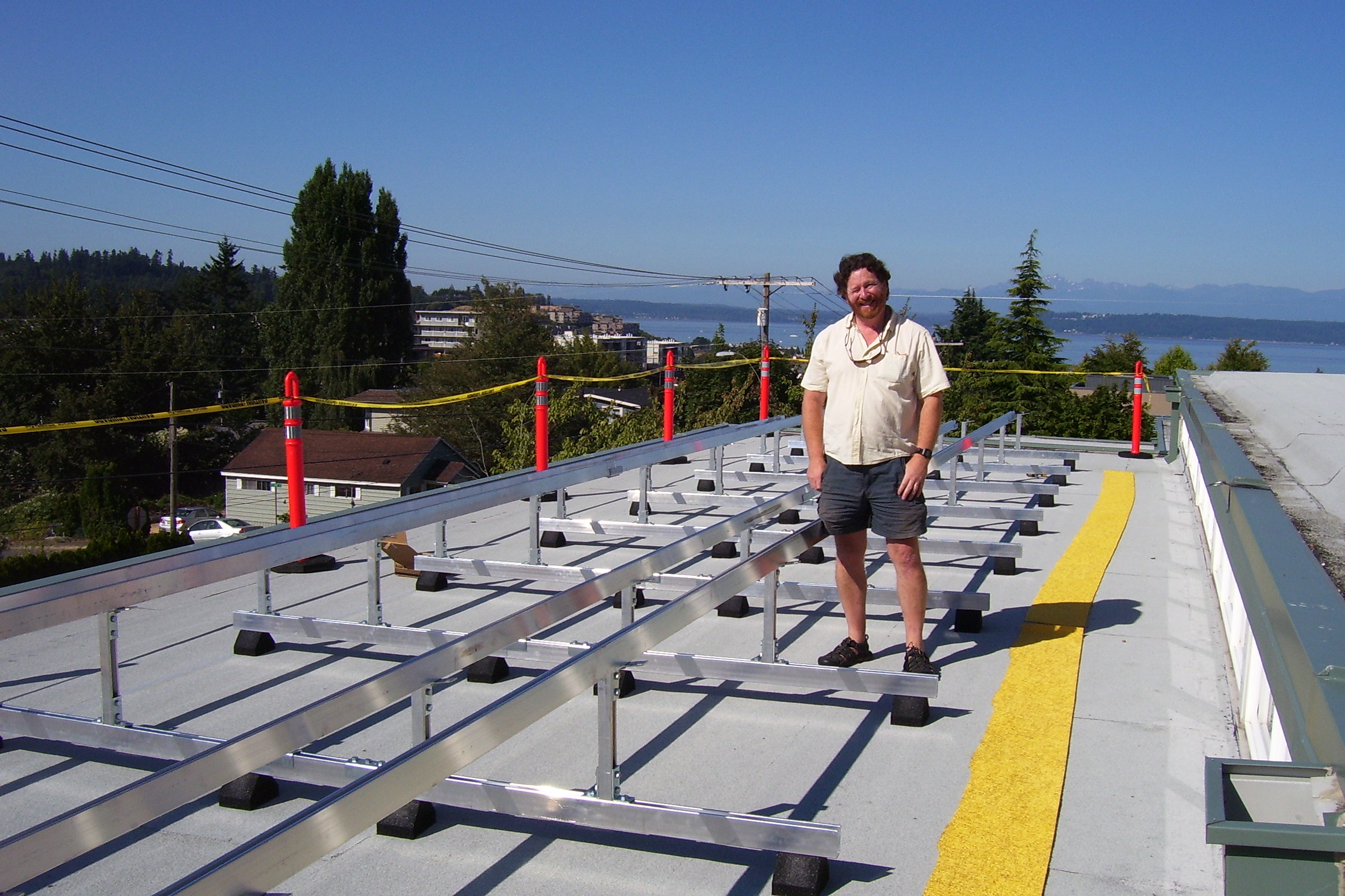 Chris Herman In 2011 Standing Next To The Racks That Were Installed Friday  In Preparation For
