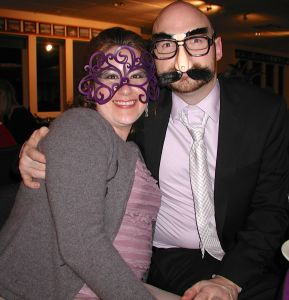 A masked Greg Urban, with his wife Ivette, was honored for individual service to the chamber.