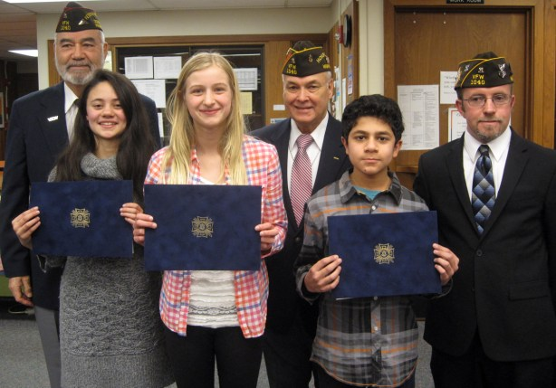 "VFW Post 1040 on Jan. 16 presented awards to winners of the Patriot's Pen youth essay-writing contest at College Place Middle School. Students wrote an essay on this year's theme, ""What Patriotism Means to Me."" From left, back row: Frank Martinez, Post 1040 Sr. Vice Commander; John Zambrano, Chaplain and Andy Dingman, Patriots Pen Chairman. Front Row: 1st Place winner- Samantha Dickinson; 2nd Place- Ines Broerson and 3rd Place - Yusuf Ishaque."