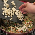 Add the diced tofu or ground meat. (If you are using ground meat, brown the meat in advance, then add to the mixture.)