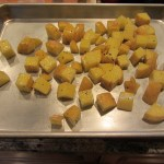 Dice the Yukon Gold Potatoes into 1-inch chunks. Toss in a large bowl with Olive Oil, Kosher Salt and Fresh Ground Black Pepper. Put on a sheet tray, and put into the preheated 400 degree oven for 45 minutes, or until crispy on the outside. Check periodically, and using a spatula, scrape the potatoes so they don't stick to the sheet tray. This will also allow them to get crispy on all sides.