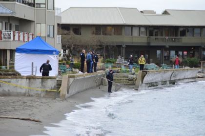 Police used nets to scour the water and beach for evidence following the discovery of the body last Friday. (Photo by Larry Vogel)