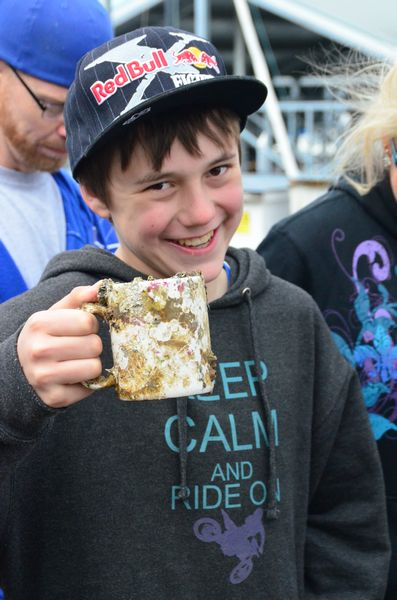 "Gabe Fullenkamp shows off a barnacle-encrusted coffee mug brought up the dive teams.   Also a certified diver, 12-year-old Fullenkamp goes to school in Colville but spends summers and other free time in Edmonds with his father. He has attended Crawley's summer camp at Sunset Bay for the past two years. ""I sure didn't want to miss this event,"" he said."