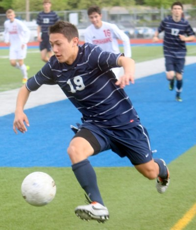 Meadowdale's Nathan Redd controls the ball.