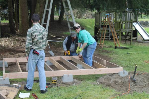 Volunteers at work building raised beds at Salem Church last weekend.