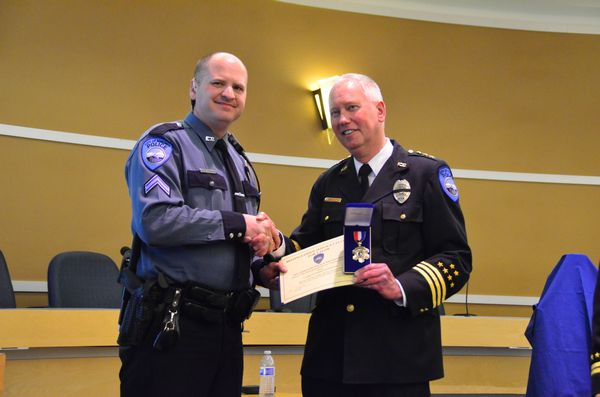 Cpl. Aaron Greenmun received a Medal of Valor for his actions in apprehending a gunman last September.  The gunman was advancing on another officer with apparent intent to shoot when Corporal Greenmun wounded him with his service rifle and took actions that led to his successful apprehension.