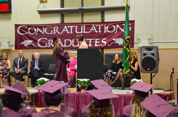 Eighteen scholarships were awarded to graduating seniors, totaling $38,125. Here Dorothy Stansberry of the Edmonds Public School Association presents one of these to graduating senior Ciera Reed.