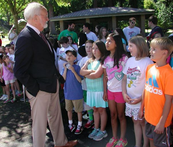 Mayor Dave Earling visits with youngsters gathered for the Tuesday ribbon-cutting for City Park's new playground equipment.