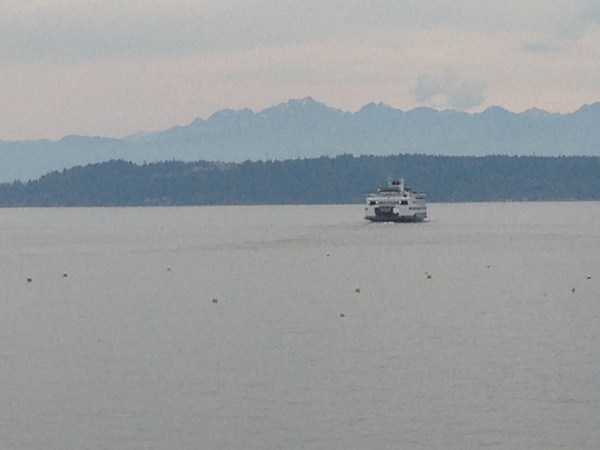 Clear sunny skies turned to a muggy haze Sunday afternoon, and Jennifer Benson captured a ferry heading into the changing sky.  The forecast for Monday is partly cloudy but still warm -- in the 80s.