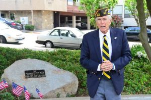 Fred Apgar, commander of VFW Post 8870, speaks at the Memorial Day dedication of the Veterans Plaza site.