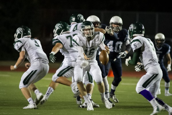 Edmonds Woodway quarterback Nick Morales pitches to running back Chantz Justice.