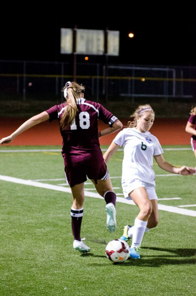Ellie Shull dribbles past a Mercer Island defender.