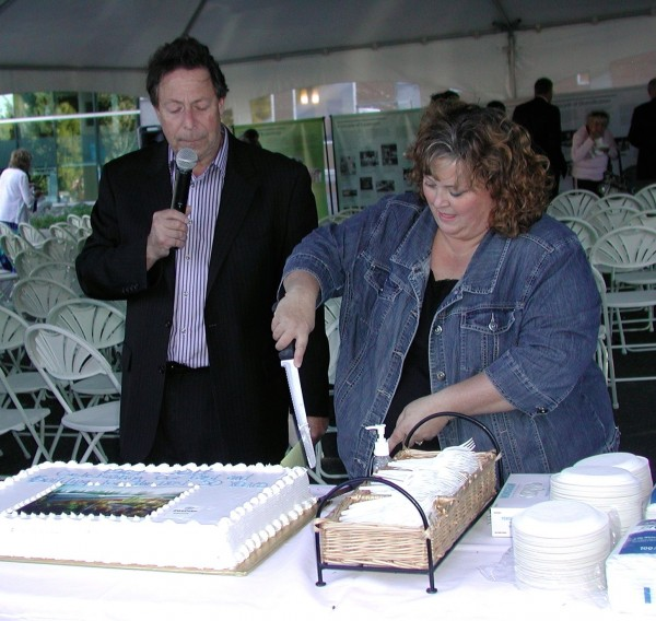 Jaffe watches as long-time Bobbi Ragland cuts the anniversary cake.