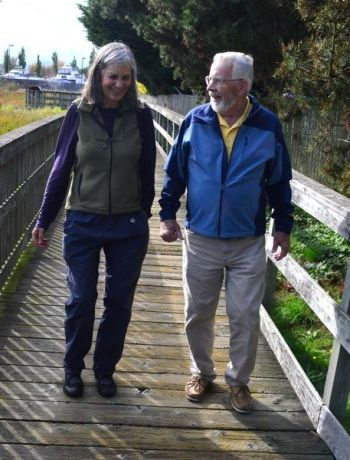 Edmonds citizen and advocate Val Stewart provides guidance to the Students Saving Salmon group.  Here she walks with Cooke along the boardwalk bordering the west edge of the Edmonds Marsh.
