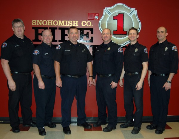 From left, Ron Schmitt, Kevin Fetter, Rob Gullickson, Keith Sharp, Chris Karg and Todd Wigal have been promoted to the rank of captain by Snohomish County Fire District 1. They were recently sworn-in during a badge-pinning ceremony at a Board of Commissioners meeting at Fire District 1 Headquarters.