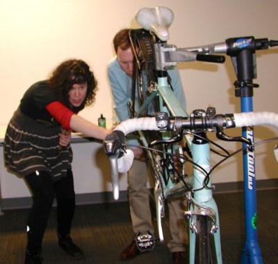 Michele Finklestein, education and outreach program assistant for the Cascade Bicycle Club, demonstrates bicycle maintenance during the open house.