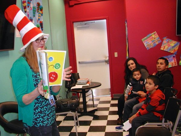 Patti Vicari, librarian at Edmonds' Chase Lake Community School, reads to children and their parents in the Revelations reading room.
