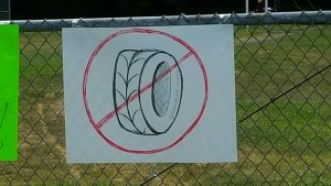A sign made by opponents of tire crumb rubber turf.
