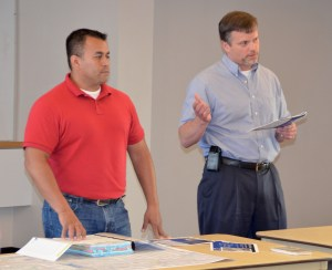 City of Edmonds Project Manager jaime Hawkins and Engineer Rob English speak during Thursday night's open house.