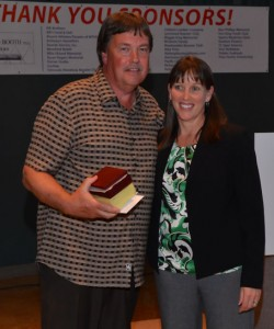 Edmonds School District Athletic Director Julie Stroncek honors Ken Allen.