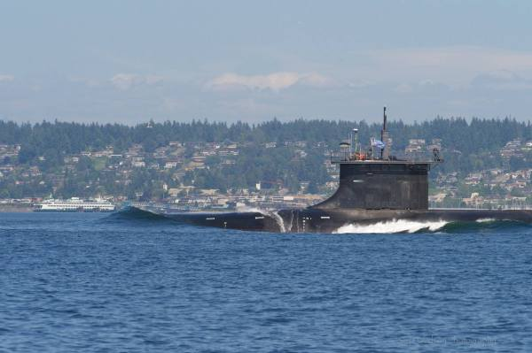 "From Stu Davidson: ""If you ever wondered what to do if a nuclear sub got between you and where you're heading... simple: YOU WAIT! This photo was taken while Davidson was motoring his boat back to Edmonds Marina. Edmonds and the ferry terminal are in the background."