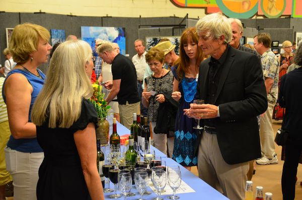 Edmonds sculptor David Varnau stops for a glass of wine