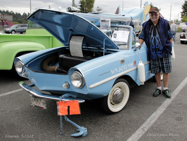 """Owner Don Ross poses with his 1964 Amphicar.  He once rode it on the Montlake Cut when the waves were especially choppy.  The car was bouncing """"like a submarine.  Had a friend with me, and he says, 'I don't want to do that again!'"""