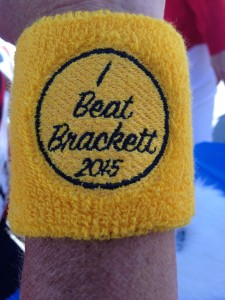 "The wristband given to those runners who actually finished ahead of ""George Brackett"" in Saturday's race. (Photo by Larry Vogel)"