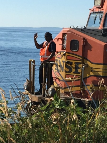 From Jennifer Benson, a train conductor waves as the train is temporarily stopped along the Edmonds waterfront Thursday afternoon. (Photo by Jennifer Benson)