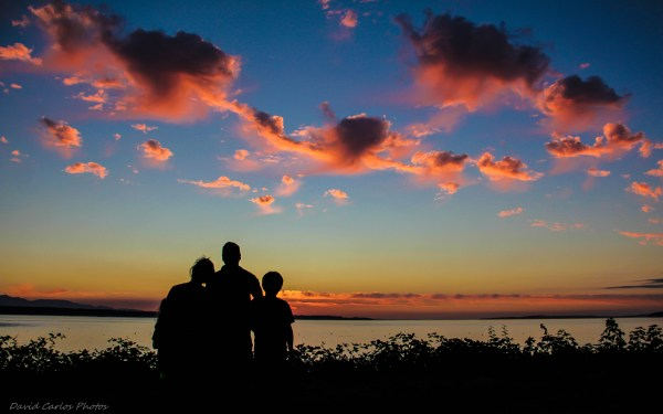 From David Carlos, a family stops to appreciate the sunset on Sunset Avenue Sunday night.