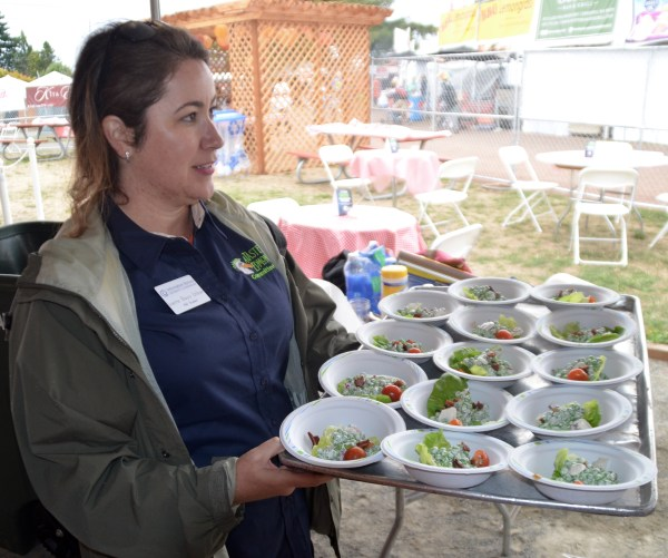 Ivette Bayo Urban brings Scott's Bar and Grill Broadway Pea Salad samples to Tasteoff judges.