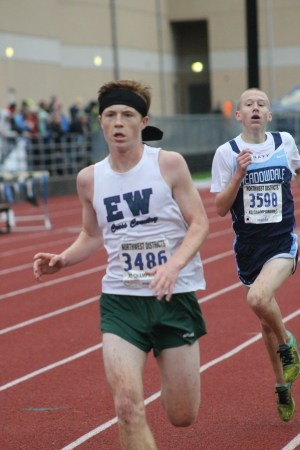 E-W's Sam McCloughan (left) finishes just ahead of Meadowdale's Colin Knechtel in the 3A boys district race on Saturday. (Photo by Doug Petrowski)