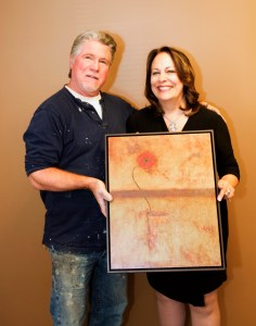"Dragonfire resident artist Michael Cadieux with Marilla Sargent holding ""Determined"" which was among the pieces made available for the ""ECA 2015 Red Carpet Gala and Auction""."
